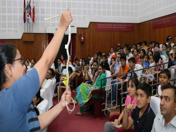 """Children and parents taking part in the """"Friends of Snake's Society"""" event at Ecological Warriors of College of Defence Management, Secunderabad."""