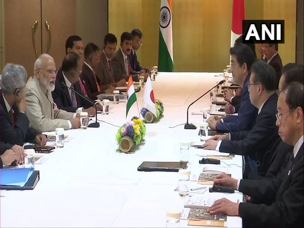 Prime Minsiter Narendra Modi with his Japanese counterpart Shinzo Abe during a meeting on Thursday in Osaka, Japan (Photo/ANI)