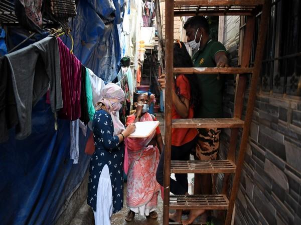 A healthcare worker conducting door-to-door survey inside Dharavi. (File photo)