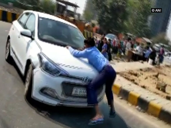 Visuals of man who grabbed a car bonnet and was dragged 2 km in Indirapuram, Ghaziabad on Wednesday.