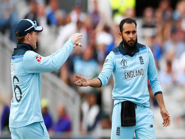 Adil Rashid celebrates with Eoin Morgan after taking a wicket