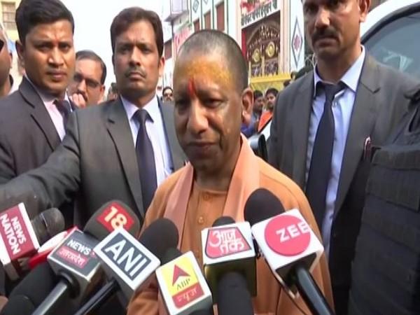 Uttar Pradesh Chief Minister Yogi Adityanath talking to reporters after visiting Hanumangarhi on Saunday. Photo/ANI