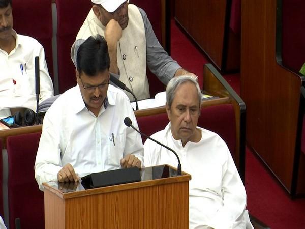Odisha Finance Minister Niranjan Pujari (left/ file photo).