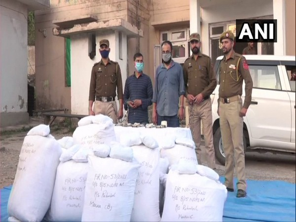 Visual of two accused held with seized contrabands in J-K's Tikri