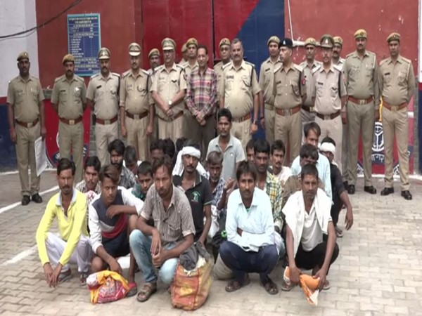 Jail authorities along with 21 prisoners who were released on Thursday in Agra. Photo/ANI