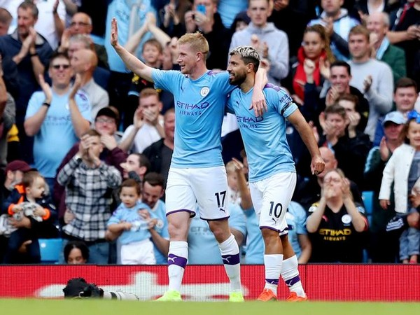 Sergio Aguero celebrates with Kevin De Bruyne after scoring goal against Brighton