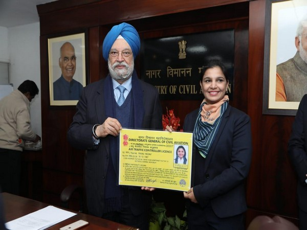 Minister of State for Civil Aviation Hardeep Singh Puri handed over first ever license to Air Traffic Controller (ATC) Payal Yadav