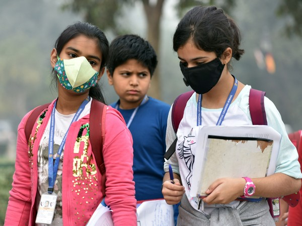 Children wearing masks in Delhi as air quality dipped to hazardous category on Friday.