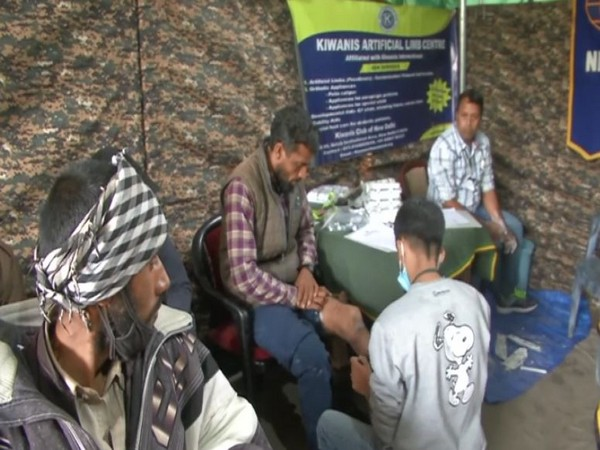 Beneficiaries giving measurements at the camp in Poonch on Tuesday.