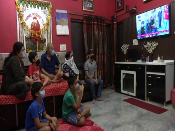 Devotees who were unable to go to Amarnath cave in light of the COVID-19 pandemic, were glued to televisions to get darshans. (Photo/ANI)