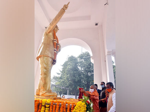 UP CM Yogi Adityanath paying floral tribute to Dr BR Ambedkar in Lucknow on Sunday. (Photo/ANI)