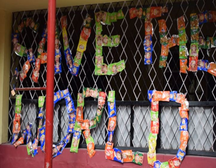 Students of Holy Cross School collect and send empty plastic wrappers back to food companies