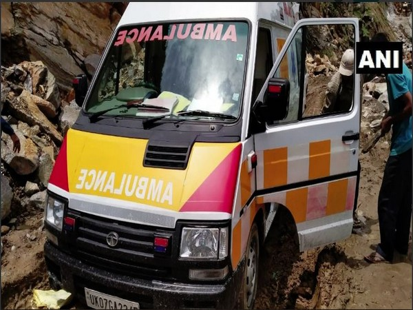 The ambulance being pushed out from the debris on a road in landslide-affected area in Pithoragarh on Wednesday. Photo/ANI