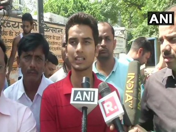 Son of BJP supporter Surendra Singh, who was shot dead early morning, talking to the media in Amethi on Sunday. (Photo/ANI)