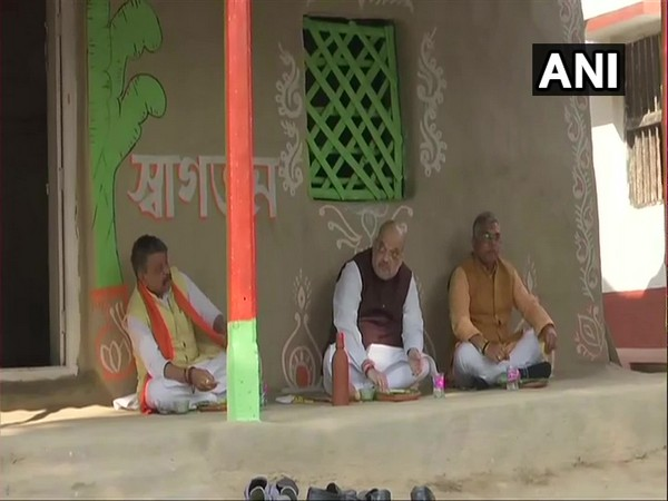 BJP leader Kailash Vijayvargiya (Left), Union Home Minister Amit Shah (Centre) and BJP leader Dilip Ghosh having lunch at farmer's house. (Photo/ANI)
