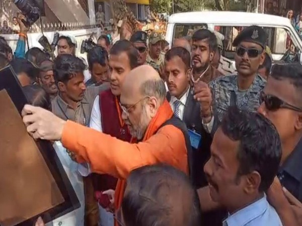 Amit Shah meets party workers in Hubali on Sunday [Photo/ANI]