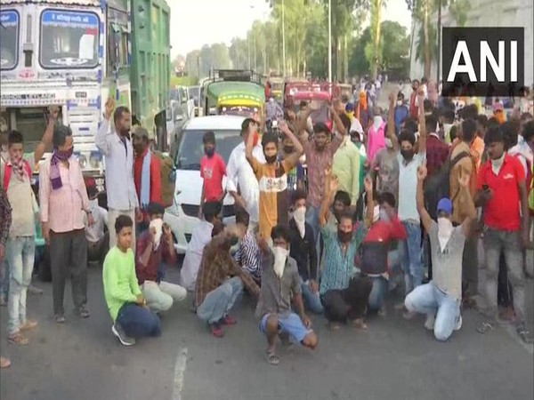 Migrant workers hold a protest at Bypass road in Amritsar on Friday. [Photo/ANI]