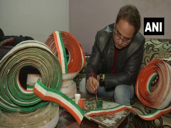 Baljinder Singh giving final touches to the national flag, which he has made by using 71,000 toothpicks, in Amritsar on Thursday. Photo/ANI