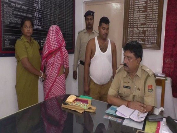 Inspector Subrata Chakraborty with the two arrested persons in Amtali police station. Photo/ANI