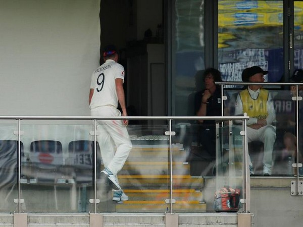 England's James Anderson walks inside the pavilion after sustaining tightness to his right calf