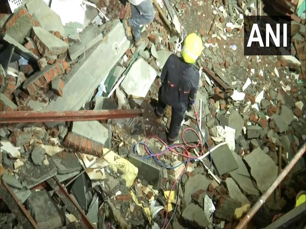 Fire fighter at the site of collapsed building in Andheri in Mumbai(File Photo/ANI)