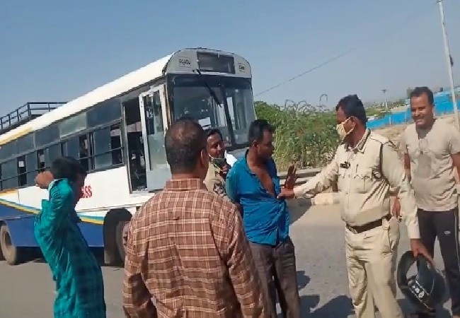 Police nabbing the accused who stole the bus in Andhra Pradesh.