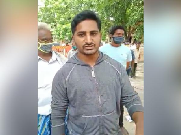 A person standing in the queue in Narasaraopeta, Andhra Pradesh