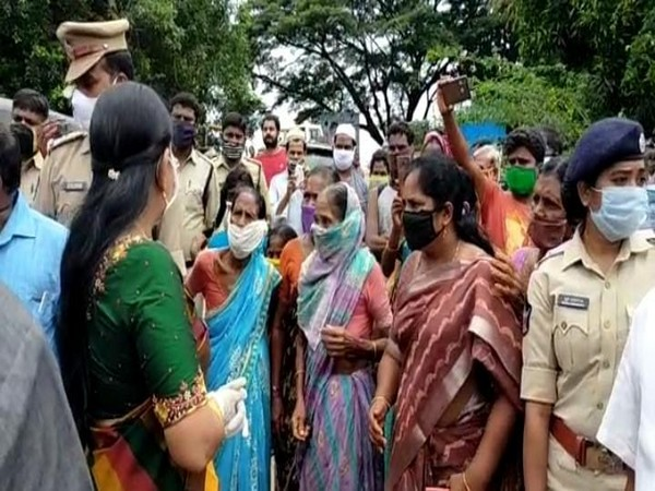 Andhra Minister Taneti Vanita while interacting with flood affected people in West Godavari district. (Photo/ANI)