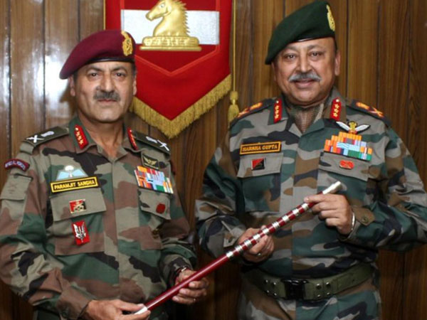 Lt Gen Paramjit Singh Sangha, left, handing the command of 'White Knight Corps' to Lt Gen Harsha Gupta, right, in Jammu on Saturday. Photo/ANI