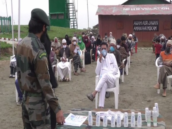 Indian Army conducts COVID-19 Awarness programme in Baramulla. (Photo/ ANI)