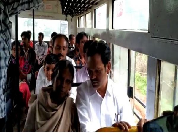 Araku MLA Chetti Phalguna interacts with a commuter in a APSRTC bus in Vishakapatnam on Friday. [Photo/ANI]