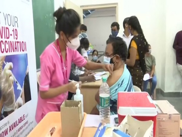 Beneficiaries getting vaccinated at the Arora's Degree and PG College in Hyderabad. (Photo/ANI)
