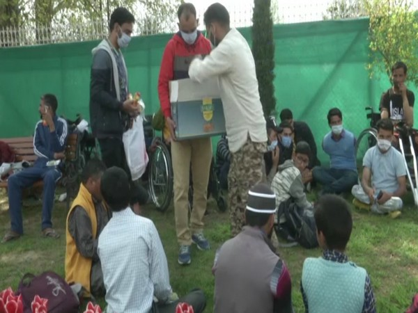 Specially-abled enjoying themselves in Srinagar's Tulip garden on Monday. (ANI)