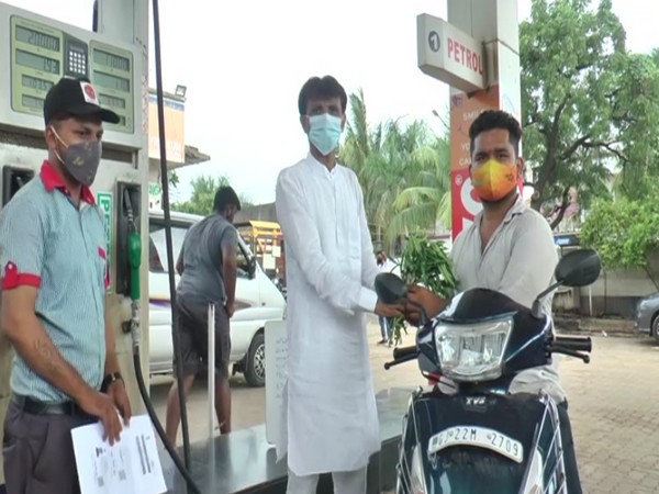 A beneficiary availing the free petrol scheme (Photo/ANI)