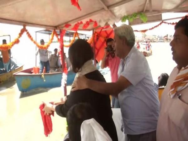 Bansuri Swaraj and Kaushal Swaraj immersing ashes of Sushma Swaraj in Ganga River in Hapur.