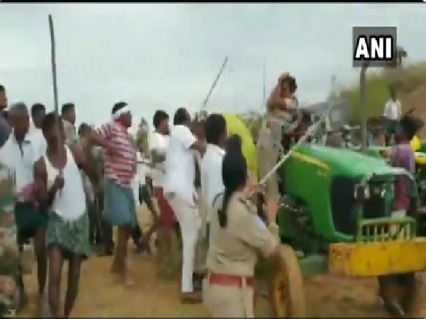 TRS workers allegedly beating women forest guard in Asifabad, Telangana on June 30. Photo/ANI