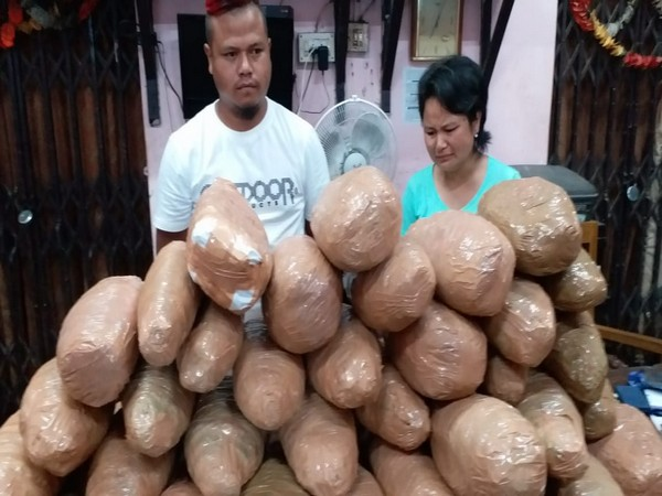 Two siblings who were arrested by the Railway Police along with the cannabis recovered from them on Monday in Guwahati. Photo/ANI