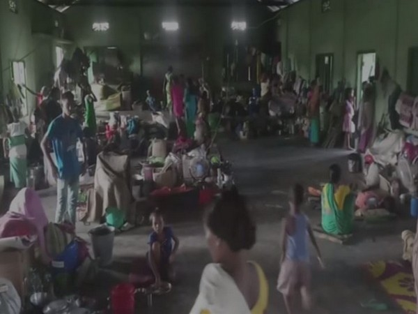 Visuals of flood victims who are lodged in a community hall in Chirang district in Assam. (Photo/ANI)
