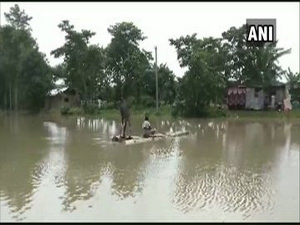 Kampur Guimari village flooded after the level of water of Brahmaputra river rises in Nagaon [Photo/ANI]