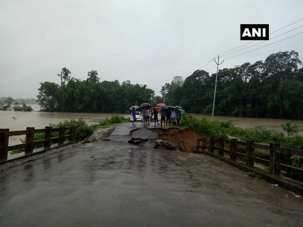 A bridge on Doomdooma-Baghjan road collapsed due to incessant rain in Tinsukia, Assam. (Photo/ANI)