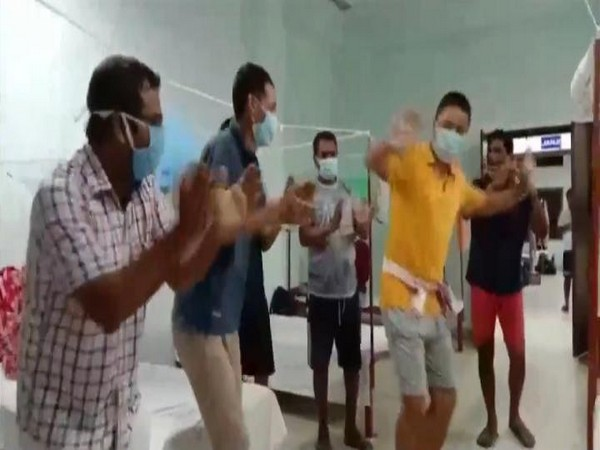 A visual from the video where Coronavirus patients dance and sing at a quarantine centre. (Photo/ANI)