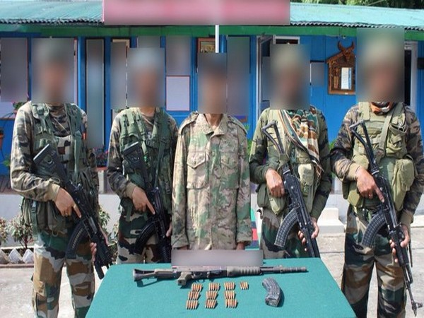 Assam Rifles jawans with the arrested ULFA (I) cadre and seized arms and ammunition. Photo/ANI