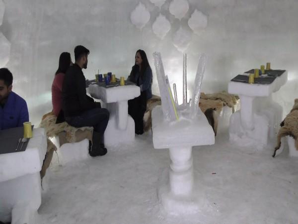 Tourist enjoying at Igloo Cafe at Gulmarg on Saturday. (Photo/ANI)
