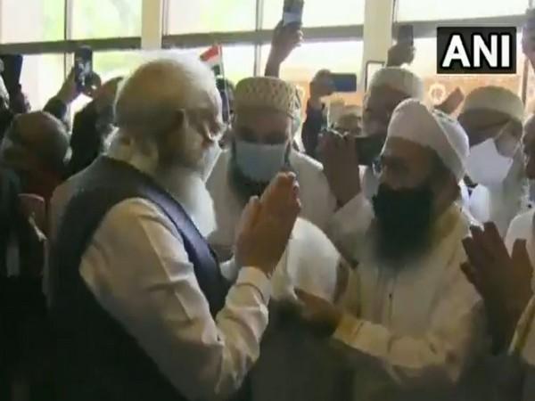 Prime Minister Narendra Modi greeting members of Indian diaspora in Bangladesh on Friday.