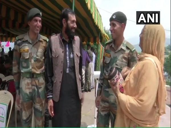 Tariq and Shabbir, brothers of slain rifleman Aurangzeb with their family in Rajouri on Monday. Photo/ANI