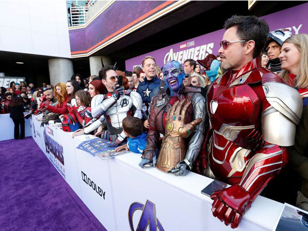 Fans dressed up in costumes await the cast members on the red carpet at the world premiere of 'Avengers: Endgame'