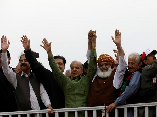 Fazal-ur Rehman, president of the Jamiat Ulema-e-Islam - Fazal (JUI-F) and Shehbaz Sharif at the Azadi March on Friday.
