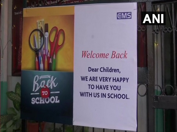 """A private school in Lucknow welcomes students with a """"Back To School"""" poster"""". (Photo/ANI)"""