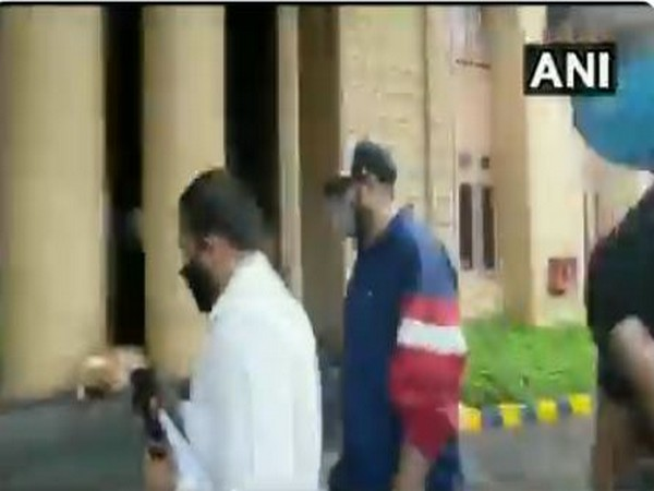 Rapper Badshah (centre) reaches Crime Branch office in Mumbai for questioning on Friday. (Photo/ANI)