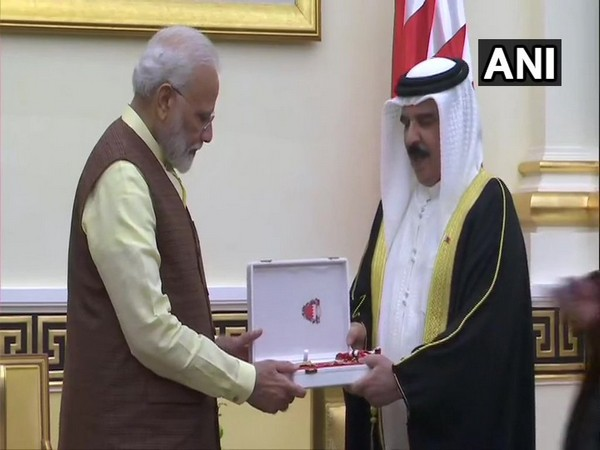 Prime Minister Narendra Modi being honoured with 'The King Hamad Order of the Renaissance' by the King of Bahrain, Hamad bin Isa Al Khalifa, in Manama on Saturday (Photo/ANI)
